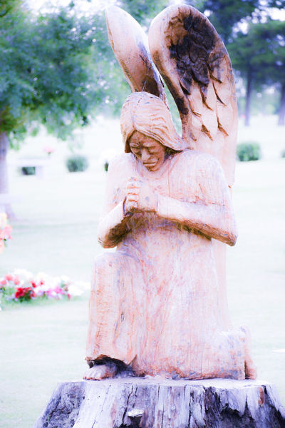 This sculpture was carved using a chainsaw on a tree that was struck by lightning and broke in half approx 10 fee above ground. This sculpture, roots and all, are permanently affixed to the grounds of a cemetery in OKC. The artist volunteered their time I am told and wishes to remain anonymous. My father is buried approx 100 feet away from this gorgeous work of art. Although slightly awkward, I could not resist taking a few photos of this post his funeral. I did receive some strange looks, but I am sure it wont be the last time I am found taking photos in strange areas. Angel Blurred Focus Cemetary High Contrast Filter Morning Soft Focus Wood Sculpture Art Is Everywhere The Portraitist - 2017 EyeEm Awards