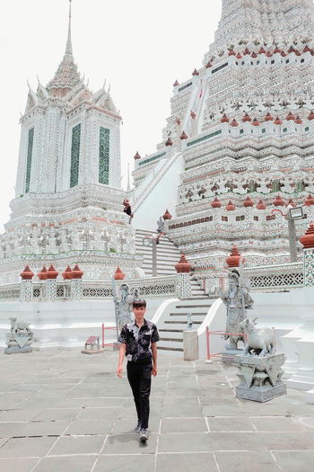 Full length of man walking against temple