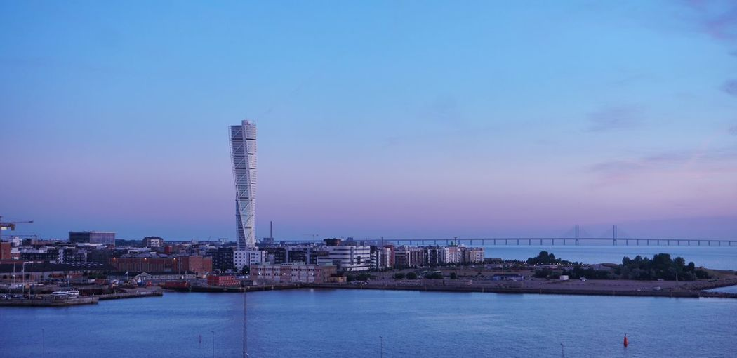 Malmö, Sweden øresund Bridge Turning Torso Malmö Sweden Built Structure Building Exterior Water Tower Skyscraper Building Sky Architecture Waterfront Sea City First Eyeem Photo