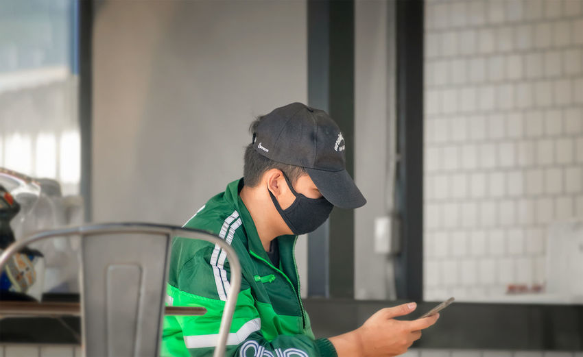 Side view of man using smart phone