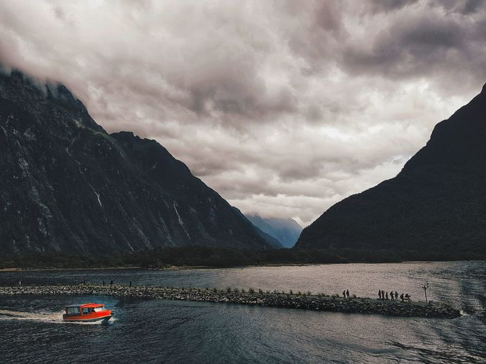 landscape The Great Outdoors - 2018 EyeEm Awards Newzealand Photos Cloudpark Milford Sound Milford Sound, New Zealand Clouds And Sky Mountain Water Dramatic Sky Summer Sky Cloud - Sky Dramatic Landscape Tranquil Scene Mountain Peak Atmospheric Mood Rocky Mountains Countryside Tranquility Scenics Pedal Boat Storm Cloud Arid Landscape