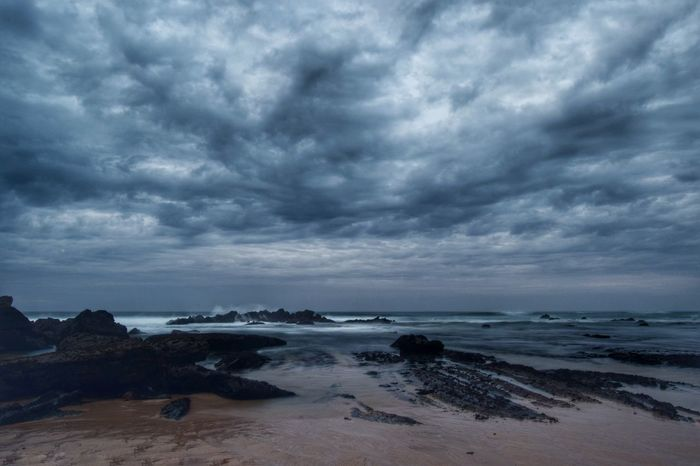 Sea Beach Storm Cloud Cloud - Sky Storm Horizon Over Water Weather Overcast Thunderstorm Dramatic Sky Scenics Travel Destinations Coastline Beauty In Nature Ominous Dark Vacations No People Nature Cloudscape Power In Nature Dusk Majestic Storm Outdoors
