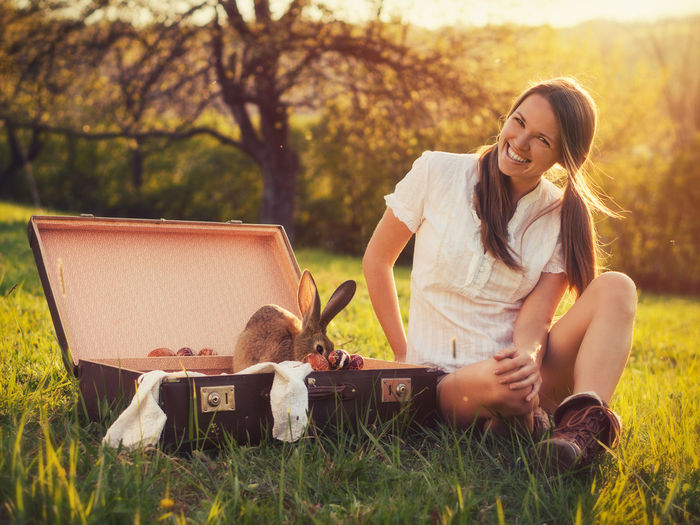 Smiling Women Happiness Leisure Activity Beautiful Woman Sitting Nature Outdoors Bunny  Rabbit Easter Easter Eggs Easter Bunny Holidays Springtime Sunset Pretty Cute Pet Grass Portrait Suitcase Vintage Retro Animal