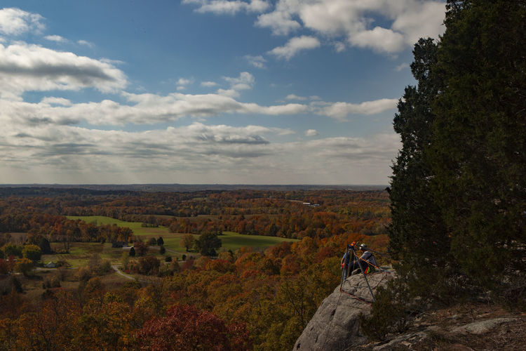 Climbers reach the top of Draper's Bluff in southern Illinois on a fall day. Draper's Bluff is the highest in elevation privately owned bluff in the state of Illinois. Cloud - Sky Sky Leisure Activity Nature Beauty In Nature Adventure Scenics - Nature Day Real People Tree Activity Lifestyles Environment Landscape Tranquility People Tranquil Scene Non-urban Scene Men Outdoors Southern Illinois  Climbing Trees Color Fall
