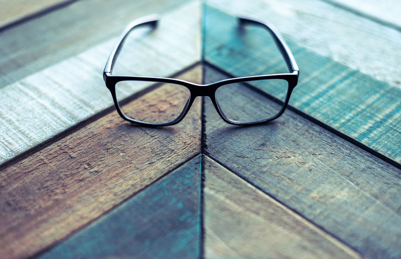 High angle view of eyeglasses on wooden table