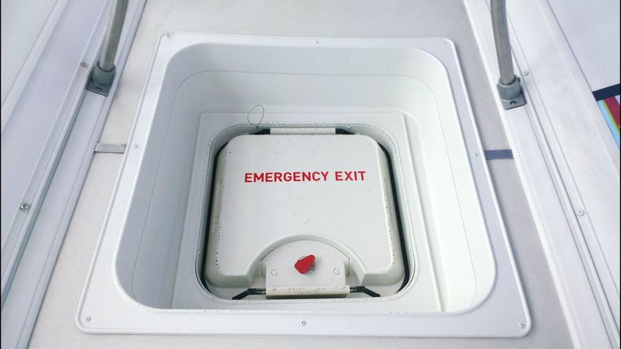 Close-Up Of Airplane Emergency Exit Door