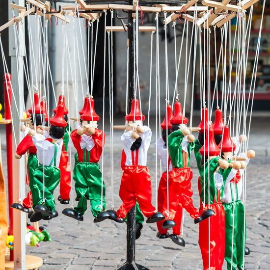 Close-up of multi colored toys hanging outdoors