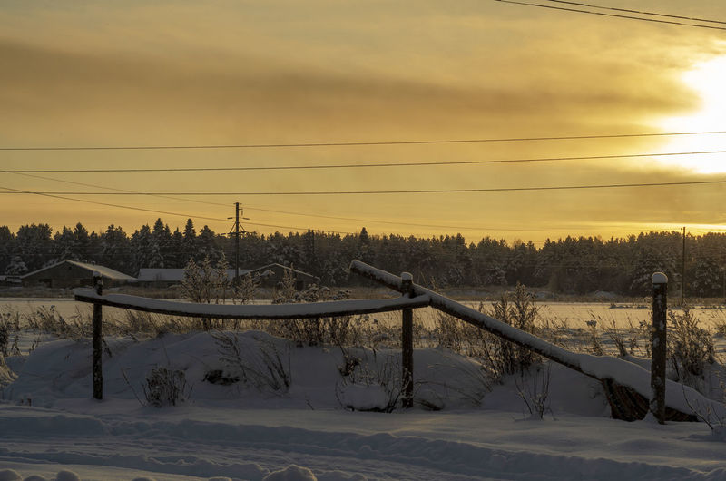 Snow Winter Cold Temperature Sky Sunset Beauty In Nature Nature Field Cloud - Sky Covering Scenics - Nature No People Tree Environment Landscape Cable Land Tranquil Scene Tranquility Electricity  Outdoors Snowcapped Mountain Power Supply