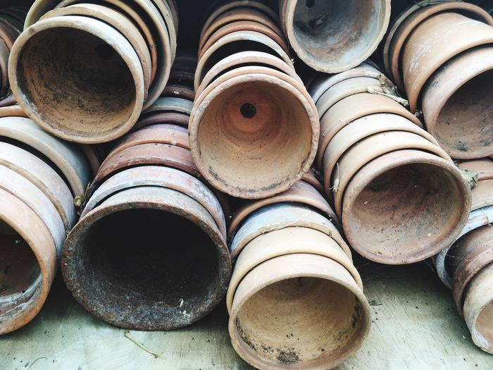 High Angle View Of Earthenware Arranged In Workshop