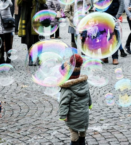 The Street Photographer - 2017 EyeEm Awards Bubble Multi Colored Fragility One Person Outdoors Bubble Wand Day Men Adult People Streetphoto Streetphotography Street City Street Daylight EyeEmNewHere Sunlight Kid Colors