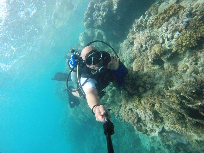 Scuba Diver Taking Selfie In Sea