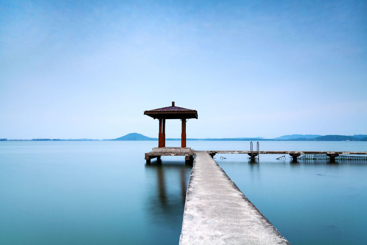 Architecture Beauty In Nature Blue Built Structure Calm Clear Sky Copy Space Horizon Over Water Idyllic Jetty Landscapes With WhiteWall Nature Ocean Pier Reflection Scenics Sea Tranquil Scene Tranquility Water Waterfront