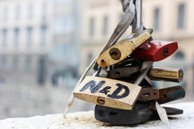 Close-up of padlocks on metal
