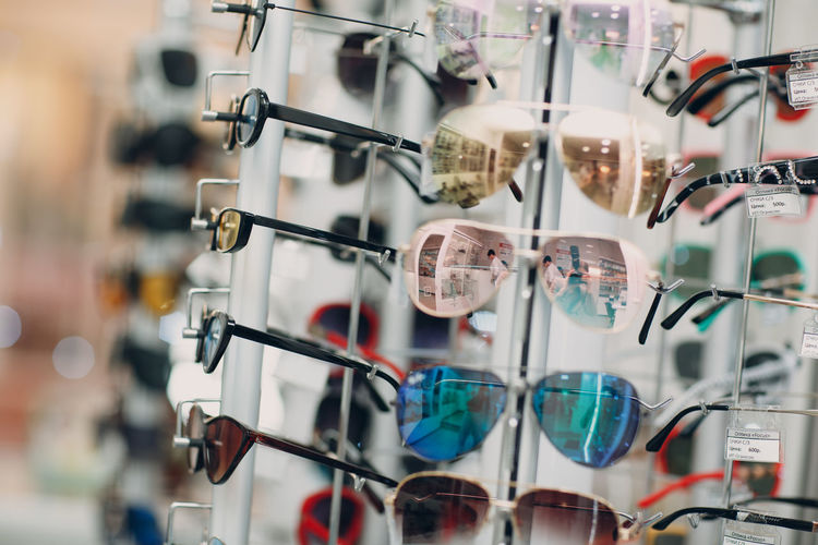Close-up of objects in rack at market