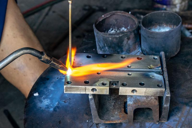 Cropped Hand Of Worker Welding Metal