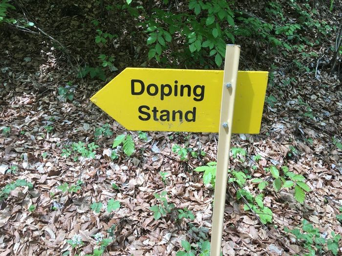 Doping Kurioses  Verpflegung Fressstand Dopeart DOPE Dopephotography Doping Stand Doping Text Communication Western Script Sign Yellow Plant Day Warning Sign Information Outdoors