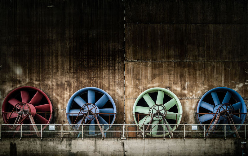 Colored fans Architecture Backgrounds Blue Built Structure Colored Fan Full Frame Green Old Red Repetition Side By Side Urbex Wall Fine Art Photography