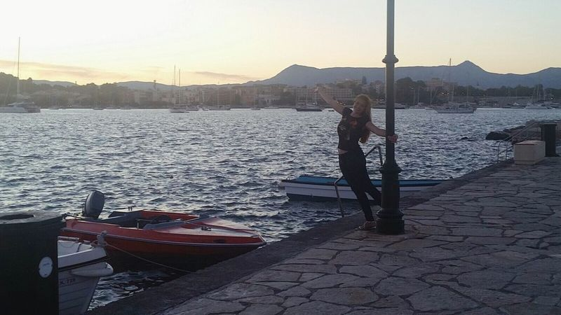One Person Sunset Water Full Length Real People Standing Leisure Activity Nature Transportation Outdoors Nautical Vessel Day Lifestyles Sky Mountain Women Clear Sky Beauty In Nature One Woman Only Only Women