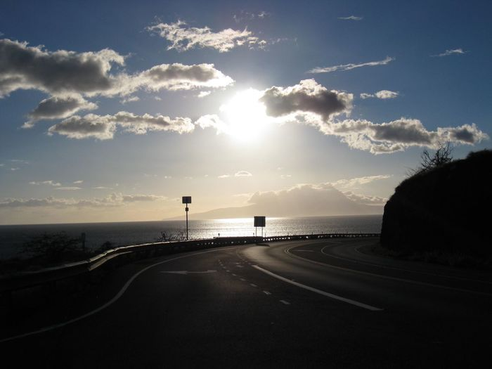 Curved Road By Sea Against Sky