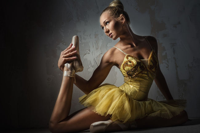 Lovely ballerina in yellow tutu Alone Artist Attractive Female Balance Ballerina Ballet Ballet Dancer Ballet Tutu Beautiful Woman Blonde Caucasian Choreography Elegant Exercise Flexibility People Performance Pirouette Pose Professional Dancer Slim Studio Shot Woman Young Adult