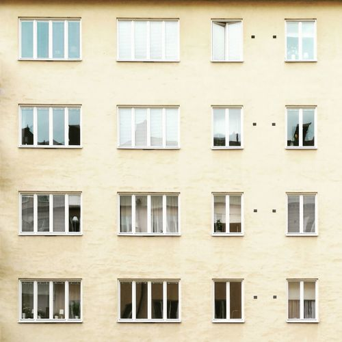 Apartment Architecture Backgrounds Building Building Exterior Built Structure City Day Full Frame Glass - Material In A Row Low Angle View No People Order Outdoors Pattern Repetition Residential District Side By Side Wall Window