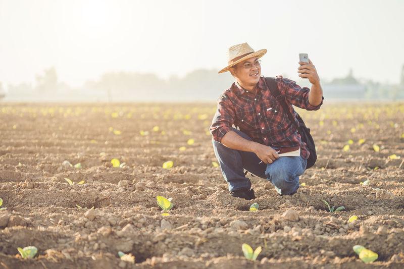 Full length of man wearing hat on field