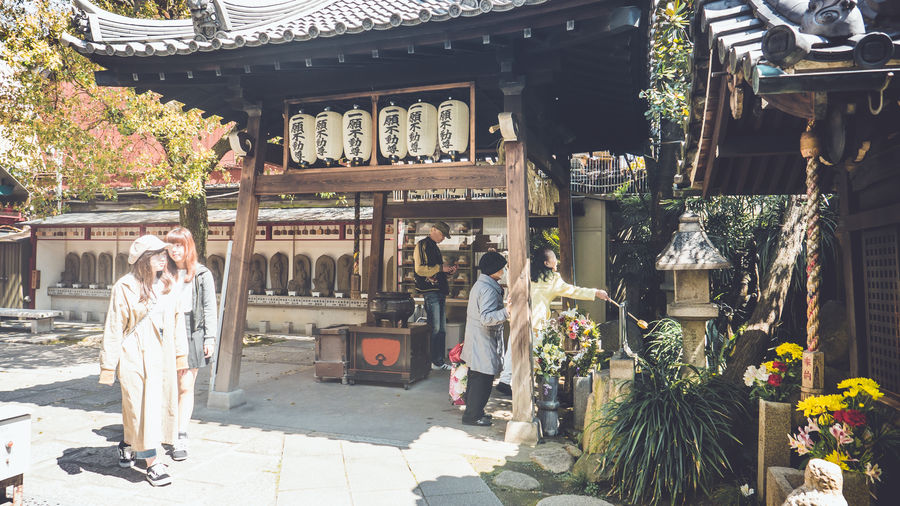 Architecture Building Exterior Built Structure Day Japan Japan Photography Lifestyles Men Outdoors People Place Of Worship Real People Religion Spirituality Sunlight
