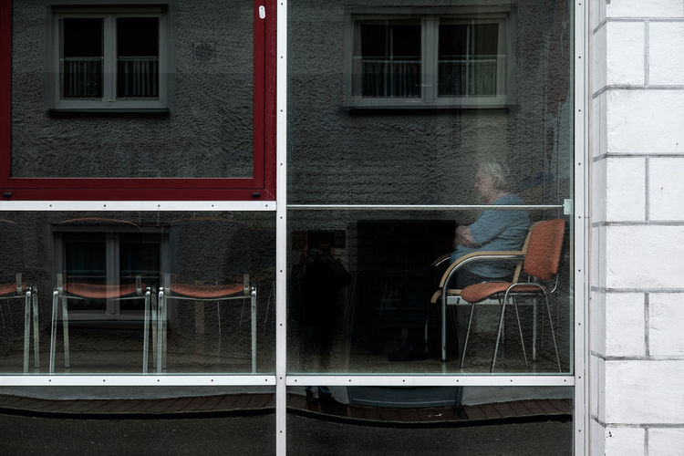 Reflection of man on window