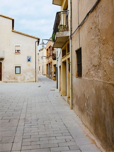 Spain, Caldes de Malavella Exploring SPAIN Caldes De Malavella Travel Destinations Holiday Vacations EyeEm Selects Built Structure Building Exterior Architecture Building Direction The Way Forward Residential District City No People Diminishing Perspective Street Cobblestone Footpath Day