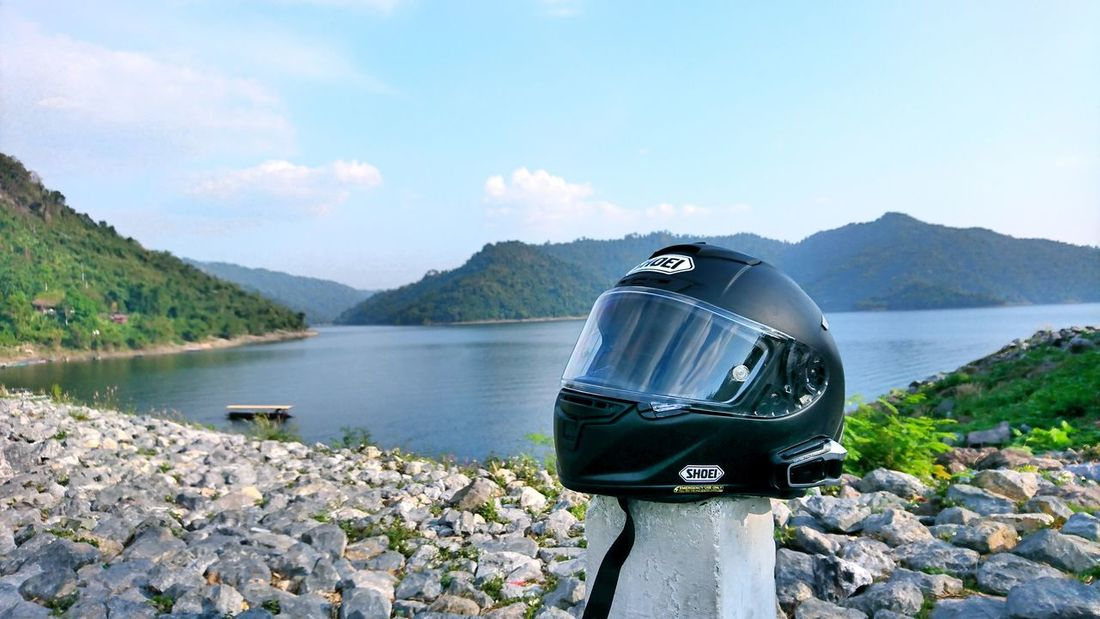 shoei in the dam Holiday Vacation Helmet Shoei X-14 Packtalk Khundanprakanchon Dam Hill Motorcycle Trip Sunny NakhonNayok Thailand Sony Xperia Xz Water Lake Mountain Nature Rock - Object No People Outdoors Travel Destinations Scenics Sky Day