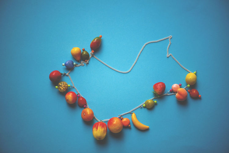High angle view of berries on table against blue background