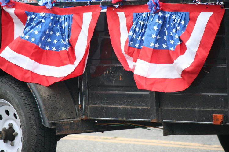 American flag on vehicle trailer during independence day parade