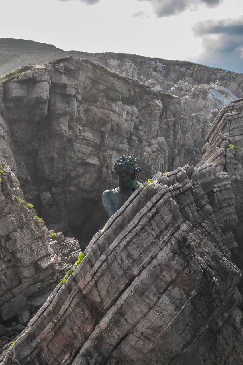 solid, rock formation, rock, rock - object, nature, mountain, day, adventure, climbing, beauty in nature, leisure activity, sky, real people, geology, physical geography, low angle view, outdoors, lifestyles, activity, people, formation, eroded