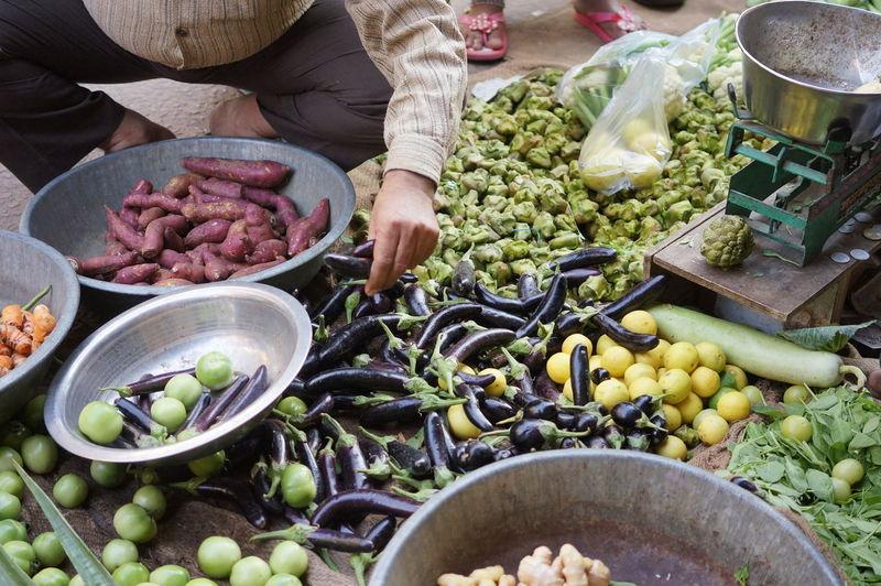 Man buying vegetables at market