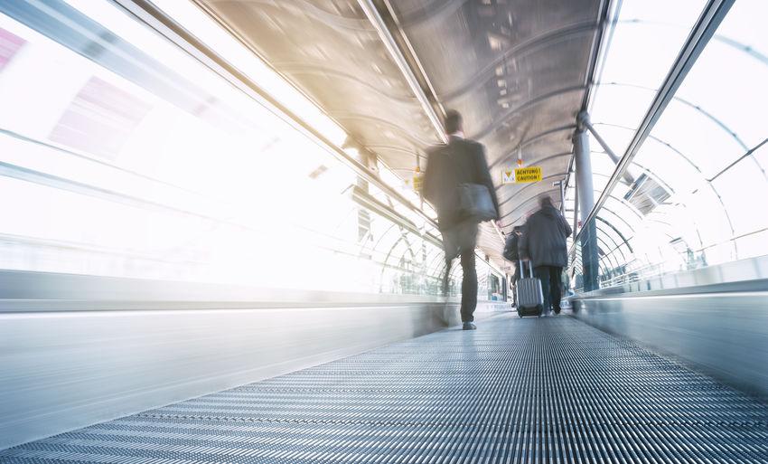 Rear view of man walking at airport