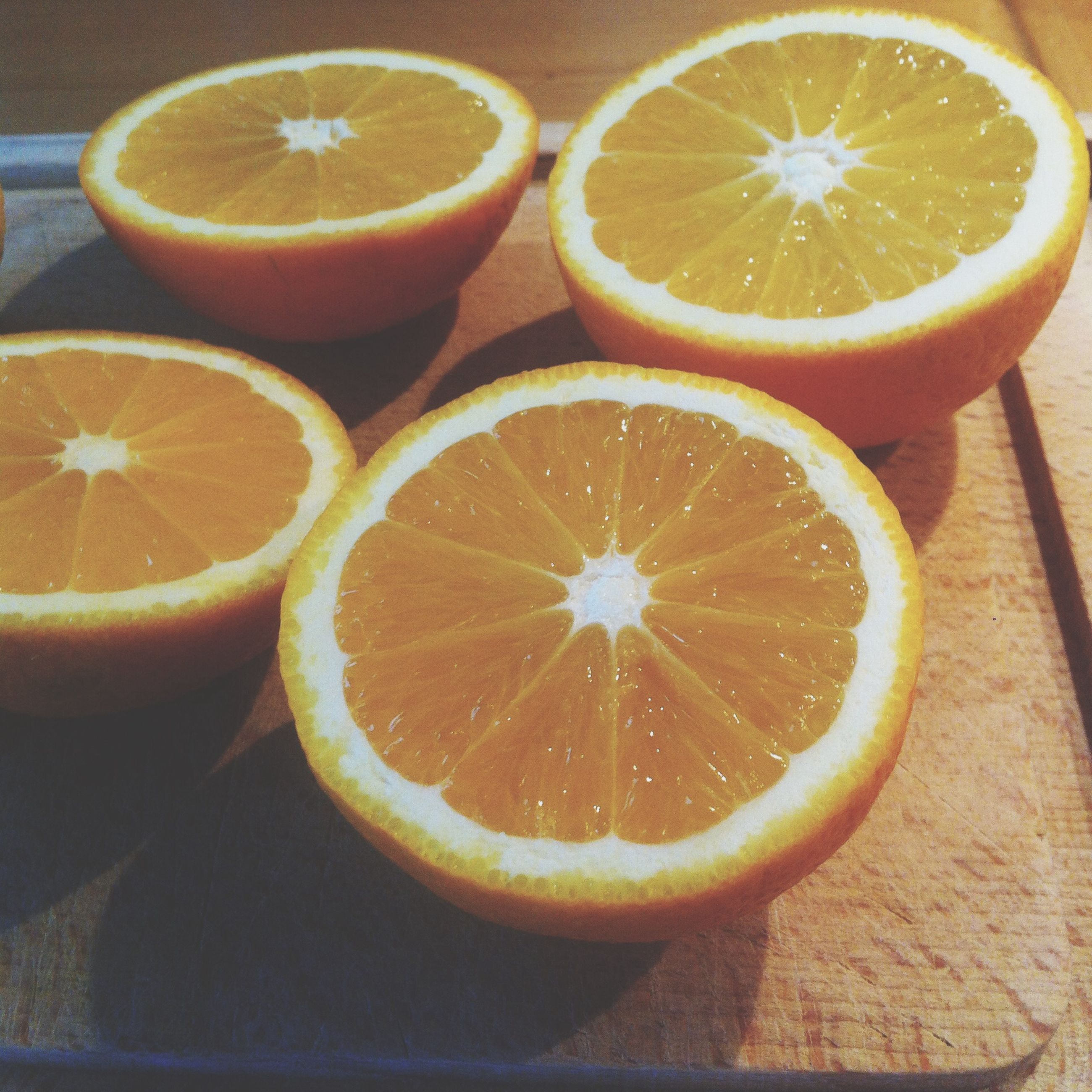food and drink, food, freshness, healthy eating, fruit, indoors, still life, table, slice, close-up, citrus fruit, cross section, orange - fruit, lemon, high angle view, organic, bowl, yellow, halved, directly above