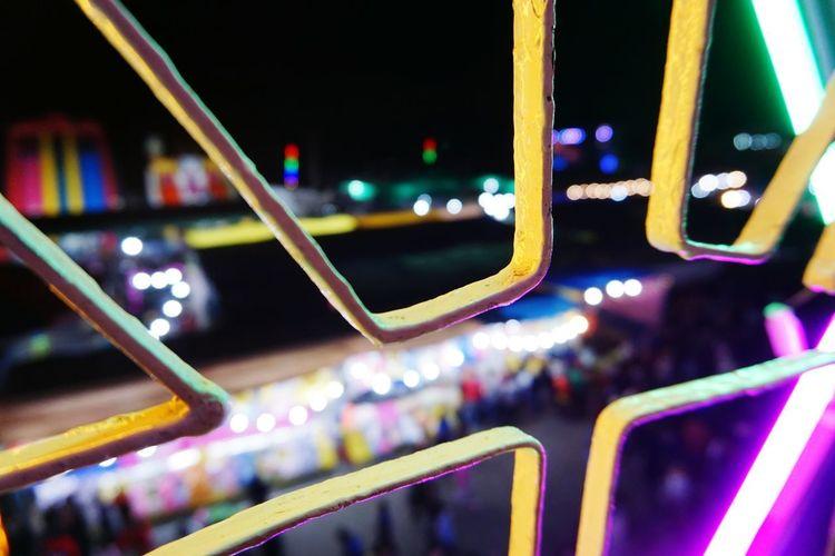 Close-up of illuminated lighting equipment in city