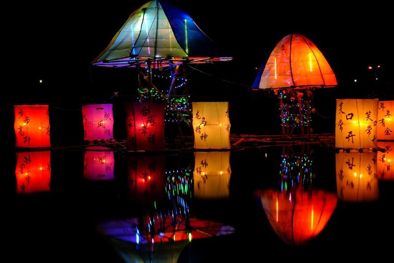 Lentern Night Illuminated Multi Colored Lighting Equipment Reflection No People Water Decoration Celebration Nature Holiday Hanging Christmas Lights Red Black Background Christmas Light Shape Outdoors Glowing