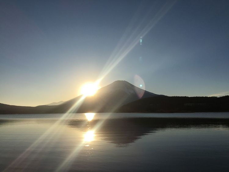 Nature Sun Beauty In Nature Water Lens Flare Sunbeam Scenics Sunlight Sky Outdoors Tranquility Reflection Tranquil Scene No People Sunset Waterfront Lake Landscape Clear Sky Day Mt.Fuji