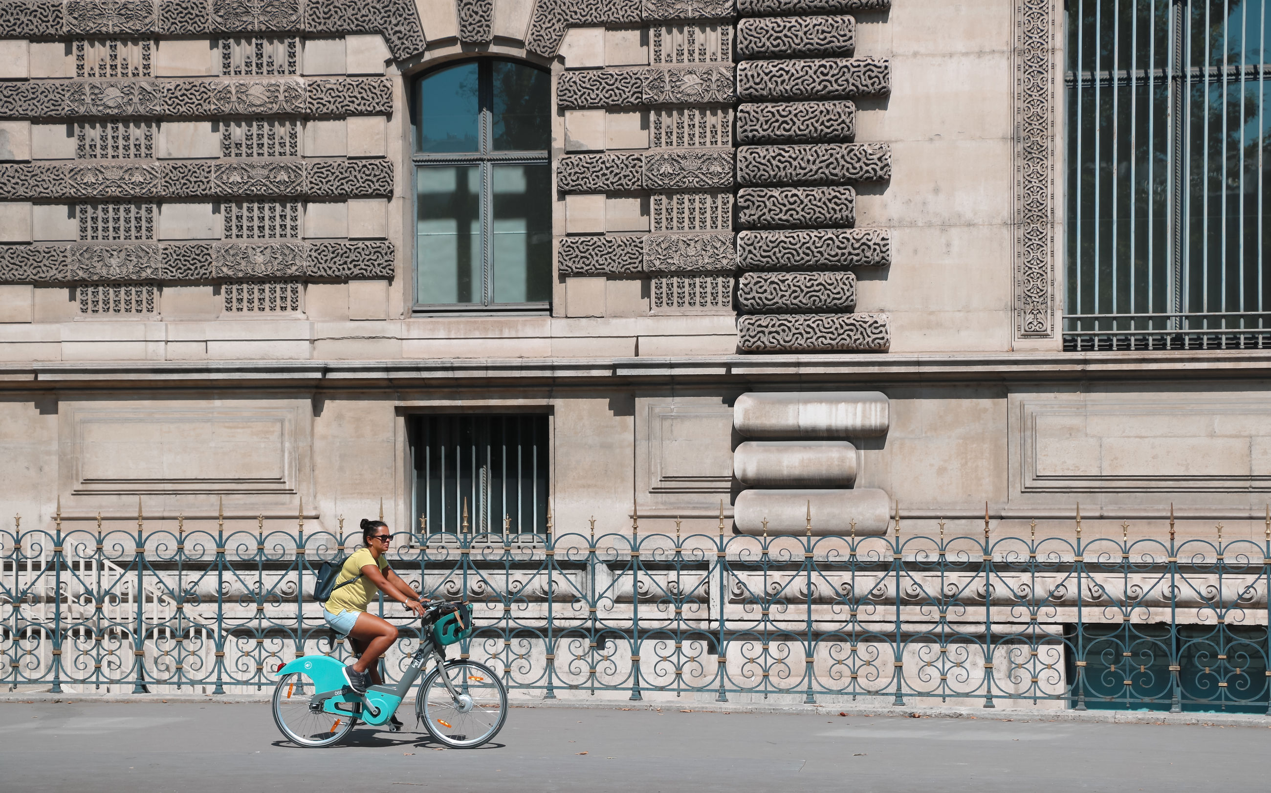 architecture, bicycle, building exterior, one person, built structure, city, full length, riding, transportation, ride, sport, day, real people, lifestyles, building, cycling, land vehicle, activity, leisure activity, outdoors, office building exterior