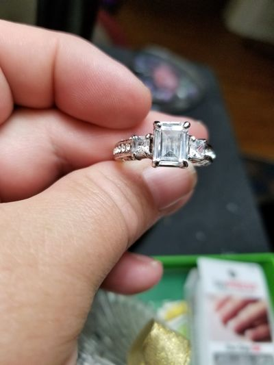 Cropped hand holding ring