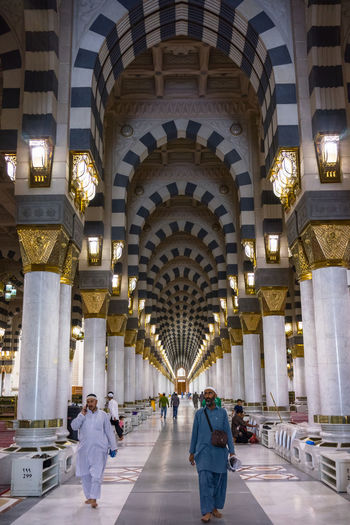 MEDINA, SAUDI ARABIA - 16TH NOV 2017; View of pillars in Mosque Al-Nabawi of Medina, . It is the second-holiest site in Islam and the mosque was built by Prophet Muhammad in 622. Medina Al Munawarah Nabawi Peace And Quiet Pilla Quran Arabic Architecture Architectural Column Curves And Lines Heritage Building Holy Place Islam Lamp Layers Maghrib Mosque Muslim Pilgrimage Praying Quran_kareem Religion