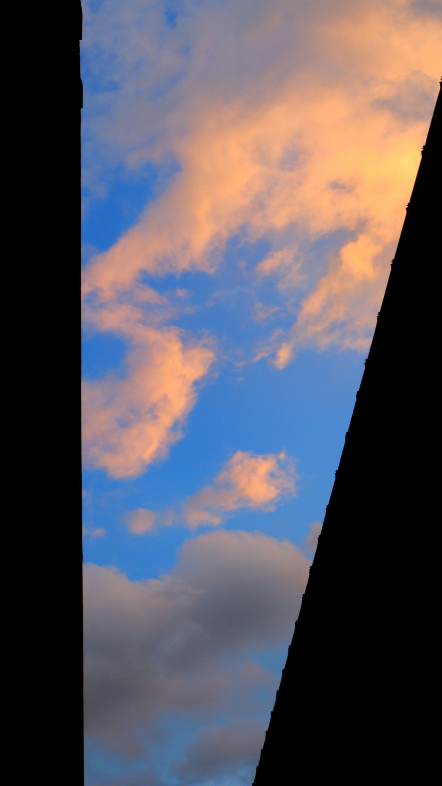 sky, cloud, blue, horizon, nature, no people, sunlight, architecture, sunset, silhouette, low angle view, built structure, reflection, building exterior, outdoors, dusk, beauty in nature, day