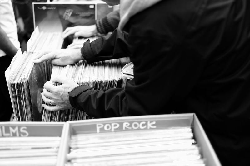 Men selecting records at store