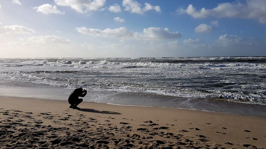 Beach Sea Sand Horizon Over Water One Person Sky Water Vacations WavePeople Nature Beauty In Nature Outdoors Day Silhouette Travel Destinations Adult Tranquility Sylt Nordsee Scenics The Day After The Heavy Storm Herwart Sylt Germany Sylt Strand Westerland