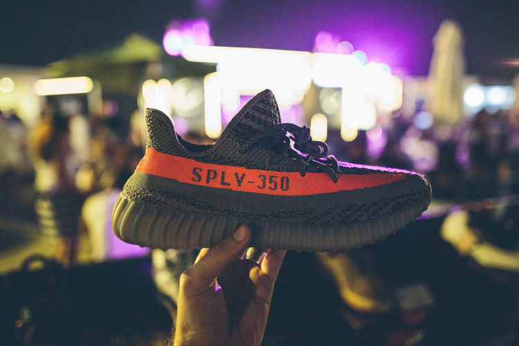 Close-up Focus On Foreground Human Body Part Human Hand Indoors  Night Nightlife People Shoe Text Yeezy Yeezy Boost Yeezy Boost 350