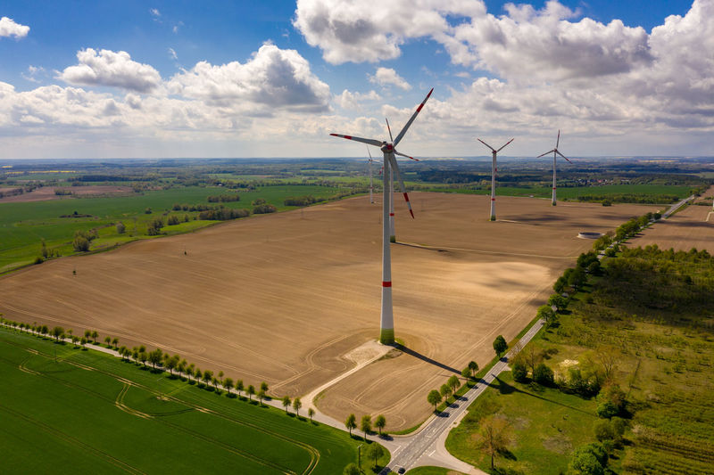 aerial view of agricultural field with windmills or wind turbines - blue sky during springtime Environment Landscape Wind Turbine Turbine Cloud - Sky Renewable Energy Wind Power Environmental Conservation Alternative Energy Sky Fuel And Power Generation Beauty In Nature Rural Scene Day Nature Land Outdoors Field Agriculture No People Aerial Photography Aerial Landscape