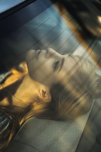 Portrait of woman lying down on floor