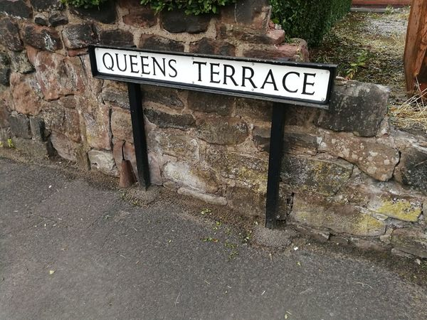 Queens Terrace street name sign Queens Terrace Communication Text Guidance Capital Letter Western Script Close-up Street Name Sign Road Sign Written