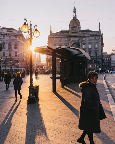 Sunrise's face. Women Lens Flare Sunlight Building Exterior Architecture Real People Street Incidental People Milano Italy Stretphotography